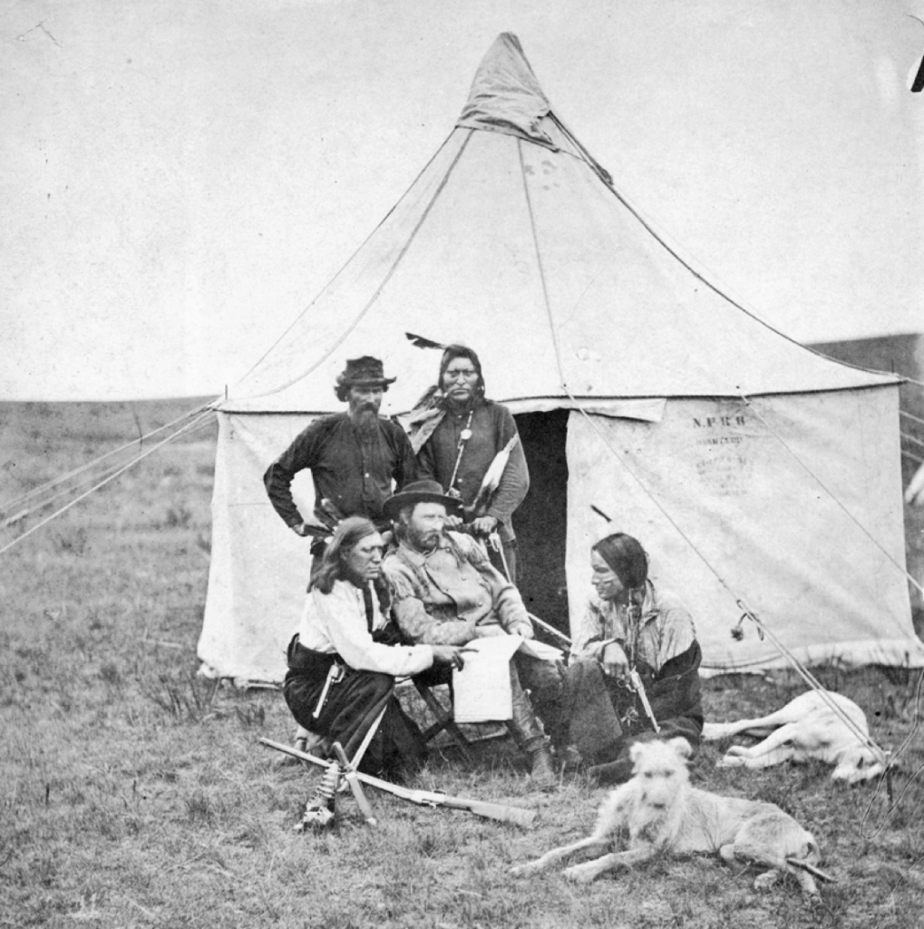 George Armstrong Custer (seated) on the 1874 Black Hills Expedition with a deerhound and sleeping greyhound. National Park Service, Little Bighorn Battlefield National Monument, LIBI_00011_004321.