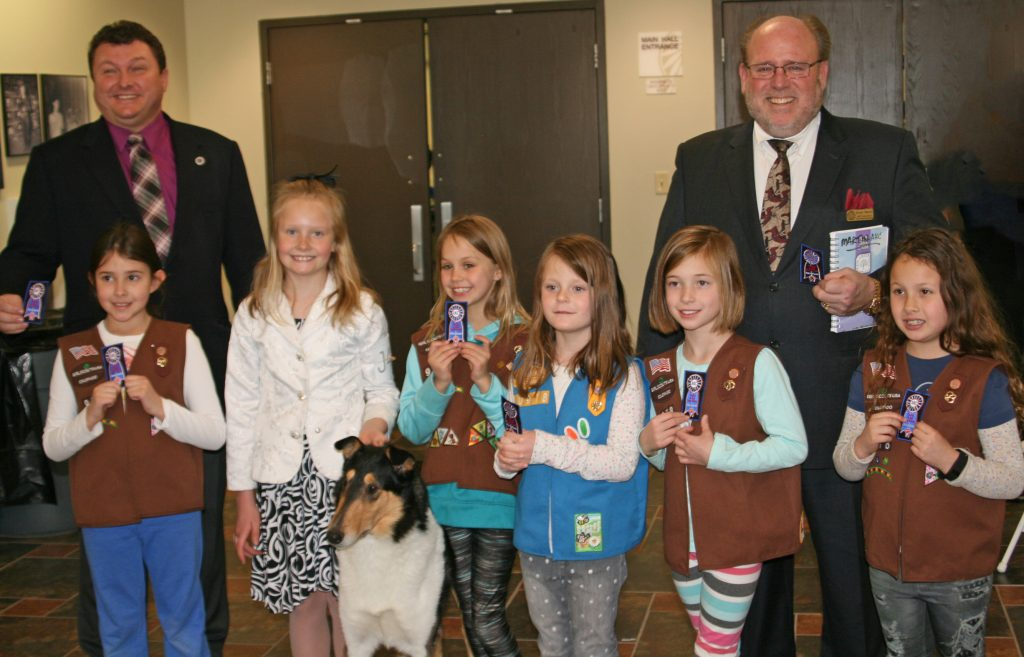 scouts - a happy girl scout troop getting their akc dog show patches with guy fisher and bryan martin and local junior handler bryanna and her smooth collie